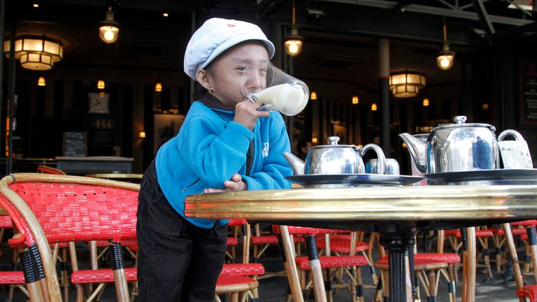 Nepalese Guinness World Record holder Khagendra Thapa Magar, 19, the second world's smallest man with 67 cm (26 inches), drinks some tea in a French cafe in Paris on October 19, 2011.  AFP PHOTO / FRANCOIS GUILLOT (Photo credit should read FRANCOIS GUILLOT/AFP via Getty Images)