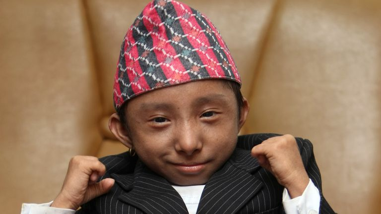 Nepalese teenager Khagendra Thapa Magar poses for a picture on September 24, 2010 in Kathmandu. Nepal Tourism Board has announced that they will use the 17-year old Thapa to promote the Visit Nepal Year 2011 along with Miss Nepal and runner-ups. Thapa is the world's shortest teen who is waiting to be declared the World's Smallest Person on October 14 when he turns 18. He weighs around 4.5 kg and is 22 inches (56 cm) tall. AFP PHOTO/Prakash MATHEMA (Photo credit should read PRAKASH MATHEMA/AFP via Getty Images)