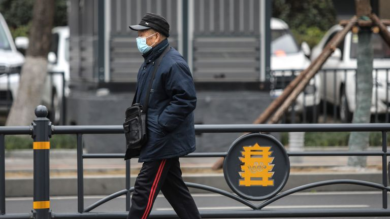 WUHAN, CHINA - JANUARY 17: (CHINA OUT) An elderly man wears a mask while walking past the closed Huanan Seafood Wholesale Market, which has been linked to cases of Coronavirus, on January 17, 2020 in Wuhan, Hubei province, China. Local authorities have confirmed that a second person in the city has died of a pneumonia-like virus since the outbreak started in December. (Photo by Getty Images)
