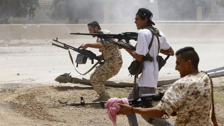 TOPSHOT - Fighters loyal to the internationally-recognised Government of National Accord (GNA) open fire from their position in the al-Sawani area south of the Libyan capital Tripoli during clashes with forces loyal to strongman Khalifa Haftar, on June 13, 2019. (Photo by Mahmud TURKIA / AFP)        (Photo credit should read MAHMUD TURKIA/AFP via Getty Images)