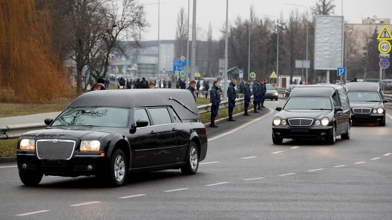 A motorcade of hearses carrying the bodies of the eleven Ukrainian victims of the Ukraine International Airlines flight 752 plane disaster arrives for a memorial ceremony at the Boryspil International Airport, outside Kiev, Ukraine January 19, 2020. REUTERS/Gleb Garanich