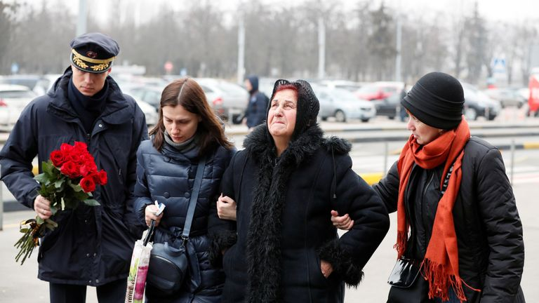 Relatives of the eleven Ukrainian victims of the Ukraine International Airlines flight 752 plane disaster and crew members arrive for a memorial ceremony at the Boryspil International Airport, outside Kiev, Ukraine January 19, 2020. REUTERS/Gleb Garanich