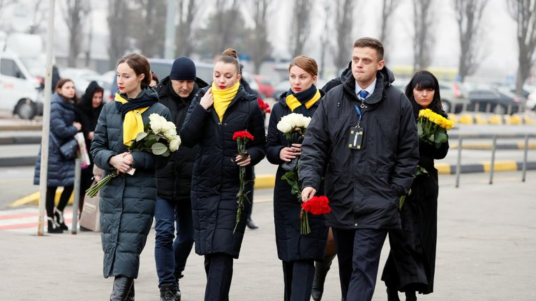 Crew members of the Ukraine International Airlines arrive for a memorial ceremony for the eleven Ukrainian victims of the Ukraine International Airlines flight 752 plane disaster, at the Boryspil International Airport, outside Kiev, Ukraine January 19, 2020. REUTERS/Gleb Garanich