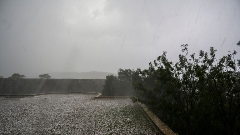 CANBERRA, AUSTRALIA - JANUARY 20: Golf ball-sized hail is shown at Parliament House on January 20, 2020 in Canberra, Australia. The large hailstorm hit Canberra this afternoon, with the Bureau of Meteorology predicting more storms were likely from north of Newcastle to the New South Wales-Victoria border on the coast. (Photo by Rohan Thomson/Getty Images)