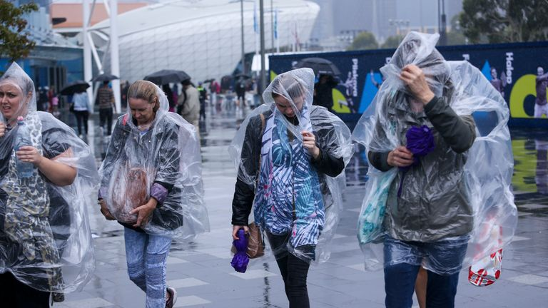 MELBOURNE, AUSTRALIA - JANUARY 20: Crowds shelter from the rain on day one of the 2020 Australian Open at Melbourne Park on January 20, 2020 in Melbourne, Australia. (Photo by Wayne Taylor/Getty Images)