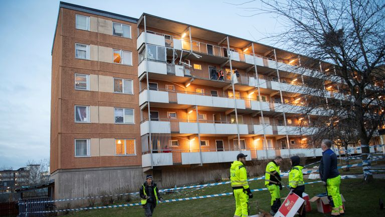 People walk outside a residential building following an explosion, in Husby, outside of Stockholm, Sweden January 21, 2020. Fredrik Sandberg/TT News Agency/via REUTERS ATTENTION EDITORS - THIS IMAGE WAS PROVIDED BY A THIRD PARTY. SWEDEN OUT. NO COMMERCIAL OR EDITORIAL SALES IN SWEDEN.