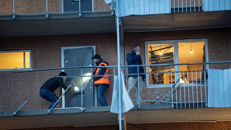 Security personnel inspect the site at residential building following an explosion, in Husby, outside of Stockholm, Sweden January 21, 2020. Fredrik Sandberg/TT News Agency/via REUTERS ATTENTION EDITORS - THIS IMAGE WAS PROVIDED BY A THIRD PARTY. SWEDEN OUT. NO COMMERCIAL OR EDITORIAL SALES IN SWEDEN.
