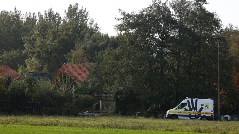 An animal ambulance is seen at the site of a remote farm where a family spent years locked away in a cellar, according to Dutch broadcasters' reports, in Ruinerwold, Netherlands October 16, 2019. REUTERS/Eva Plevier