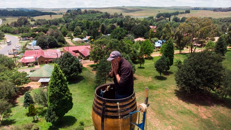 An areal view shows Vernon Kruger, 52, holding his face while standing in a barrel at the top of a pole 25 metres above the ground in Dullstroom on January 16, 2020. - Vernon Kruger is about to break a Guinness World record set by himself in 1997 where he sat on pole for 54 days. He started his new attempt on November 14, 2019 and by  January 20, 2020 Kruger will reach his goal of spending 64 days sitting on pole. (Photo by ANTOINE DEMAISON / AFP) (Photo by ANTOINE DEMAISON/AFP via Getty Images)