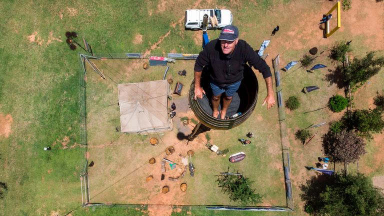 An areal view shows Vernon Kruger, 52, standing in a barrel at the top of a pole 25 metres above the ground in Dullstroom on January 16, 2020. - Vernon Kruger is about to break a Guinness World record set by himself in 1997 where he sat on pole for 54 days. He started his new attempt on November 14, 2019 and by  January 20, 2020 Kruger will reach his goal of spending 64 days sitting on pole. (Photo by ANTOINE DEMAISON / AFP) (Photo by ANTOINE DEMAISON/AFP via Getty Images)