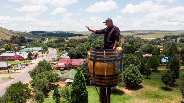 An areal view shows Vernon Kruger, 52, gesturing while standing in a barrel at the top of a pole 25 metres above the ground in Dullstroom on January 16, 2020. - Vernon Kruger is about to break a Guinness World record set by himself in 1997 where he sat on pole for 54 days. He started his new attempt on November 14, 2019 and by January 20, 2020 Kruger will reach his goal of spending 64 days sitting on pole. (Photo by ANTOINE DEMAISON / AFP) (Photo by ANTOINE DEMAISON/AFP via Getty Images)