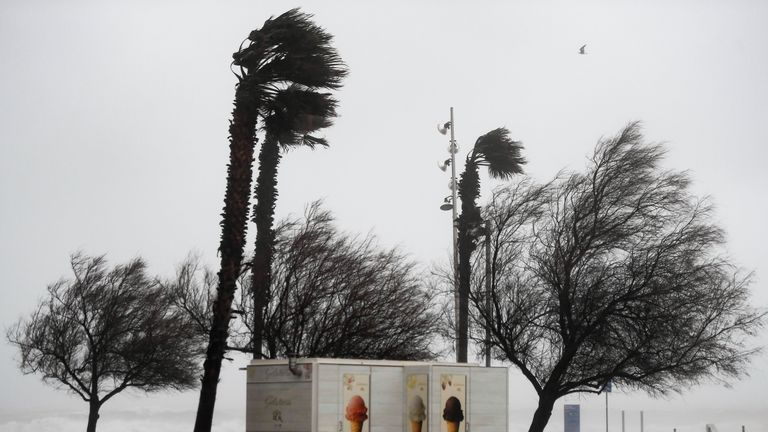 Strong wind blows in El Bogatell beach in Barcelona as storm Gloria batters Spanish eastern coast on January 21, 2020. - Freezing winds, heavy snow and rain lashed parts of Spain yesterday, killing three people, forcing the closure of schools that cancelled classes for nearly 200,000 students and disrupting travel, officials said. (Photo by Josep LAGO / AFP) (Photo by JOSEP LAGO/AFP via Getty Images)