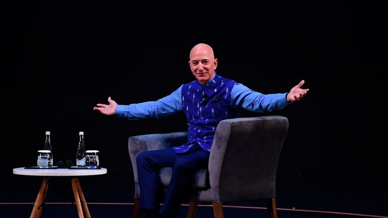 CEO of Amazon Jeff Bezos (R) gestures during the Amazon's annual Smbhav event in New Delhi on January 15, 2020. - Bezos, whose worth has been estimated at more than $110 billion, is officially in India for a meeting of business leaders in New Delhi. (Photo by Sajjad  HUSSAIN / AFP) (Photo by SAJJAD  HUSSAIN/AFP via Getty Images)