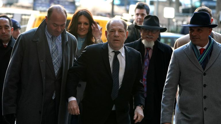 "Harvey Weinstein(C) arrives at the Manhattan Criminal Court, on January 22, 2020 for opening arguments in his rape and sexual assault trial in New York City. - Opening arguments in Harvey Weinstein's rape and sexual assault trial are due Wednesday, with the defense expected to detail ""loving"" emails between the once-mighty movie producer and his accusers. Weinstein, 67, faces life in prison if convicted of predatory sexual assault charges related to two women in the high-profile New York proceedings seen as key to the #MeToo movement. (Photo by TIMOTHY A. CLARY / AFP) (Photo by TIMOTHY A. CLARY/AFP via Getty Images)"