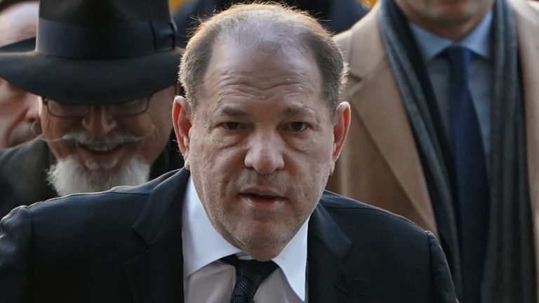 "Harvey Weinstein arrives at the Manhattan Criminal Court, on January 22, 2020 for opening arguments in his rape and sexual assault trial in New York City. - Opening arguments in Harvey Weinstein's rape and sexual assault trial are due Wednesday, with the defense expected to detail ""loving"" emails between the once-mighty movie producer and his accusers. Weinstein, 67, faces life in prison if convicted of predatory sexual assault charges related to two women in the high-profile New York proceedings seen as key to the #MeToo movement. (Photo by TIMOTHY A. CLARY / AFP) (Photo by TIMOTHY A. CLARY/AFP via Getty Images)"