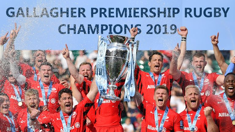 LONDON, ENGLAND - JUNE 01: Brad Barritt and Owen Farrell of Saracens lift the trophy after winning the the Gallagher Premiership Rugby Final between Exeter Chiefs and Saracens at Twickenham Stadium on June 01, 2019 in London, United Kingdom. (Photo by Dan Mullan/Getty Images)