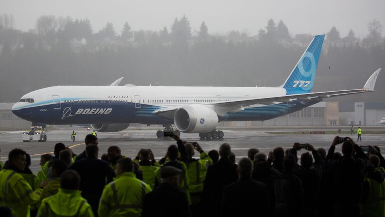 Boeing employees and guests welcome a Boeing 777X airplane returning from its inaugural flight at Boeing Field in Seattle, Washington on January 25, 2020. - Boeing's new long-haul 777X airliner made its first flight Saturday, a major step forward for the company whose broader prospects remain clouded by the 737 MAX crisis. The plane took off from a rain-slicked runway a few minutes after 10:00 am local time (1800 GMT), at Paine Field in Everett, Washington, home to Boeing's manufacturing site in the northwestern US. (Photo by Jason Redmond / AFP) (Photo by JASON REDMOND/AFP via Getty Images)