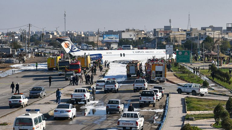 "This picture taken on January 27, 2020 in Iran's southwestern city of Bandar-e Mahshahr shows a Caspian Airlines McDonnell Douglas MD-83 aircraft which landed on a highway after it overshot the highway during its approach. No casualties were reported according to state television. - The jet was flying from Tehran's Mehrabad Airport with 135 passengers plus the plane's crew. A state TV reporter travelling on the plane told the broadcaster that the aircraft's ""back wheel had broken off, as we saw it was left on the runway"" and said the plane had been moving with no wheels before it ground to a halt. (Photo by Mostafa GHOLAMNEZAD / ISNA / AFP) (Photo by MOSTAFA GHOLAMNEZAD/ISNA/AFP via Getty Images)"