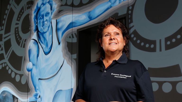 DARWIN, AUSTRALIA - AUGUST 29: Evonne Goolagong Cawley stands in front of a mural of her painted by a group of local artists, including David Collins and Indigenous artists Shaun Lee 'Hafleg' and Jesse Bell to celebrate and recognise her incredible achievements during the National Indigenous Tennis Carnival at the Darwin International Tennis Centre on August 29, 2019 in Darwin, Australia. (Photo by Darrian Traynor/Getty Images)