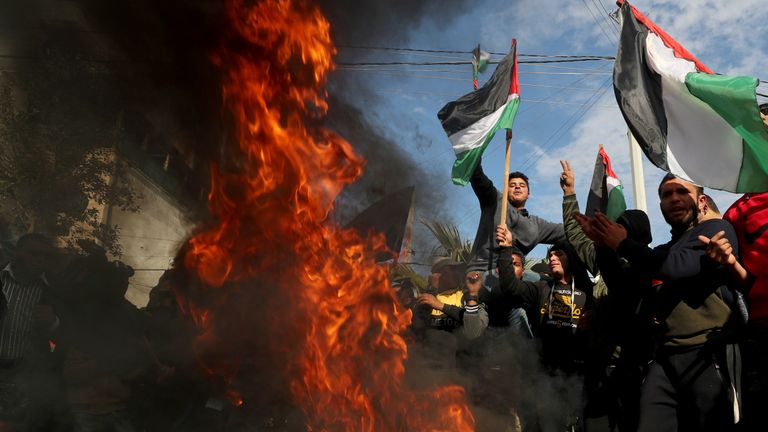 Palestinians protest as tires burn ahead of the announcement by U.S. President Donald Trump of his long-delayed Mideast peace plan, in Gaza City January 28, 2020. REUTERS/Mohammed Salem