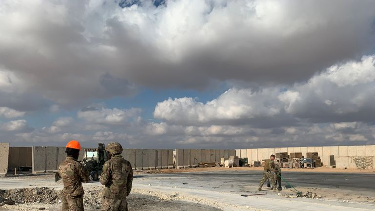 A picture taken on January 13, 2020 during a press tour organised by the US-led coalition fighting the remnants of the Islamic State group, shows US soldiers clearing rubble at Ain al-Asad military airbase in the western Iraqi province of Anbar. - Iran last week launched a wave of missiles at the sprawling Ain al-Asad airbase in western Iraq and a base in Arbil, capital of Iraq's autonomous Kurdish region, both hosting US and other foreign troops, in retaliation for the US killing top Iranian general Qasem Soleimani in a drone strike in Baghdad on January 3. (Photo by Ayman HENNA / AFP) (Photo by AYMAN HENNA/AFP via Getty Images)