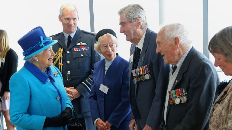 Queen Elizabeth II meets Mrs K Foster (left), Wing Commander Paul Farnes (centre) and Squadron Leader Tom Pickering as she visits the National Memorial to the Few ahead of opening a new wing in Folkestone.