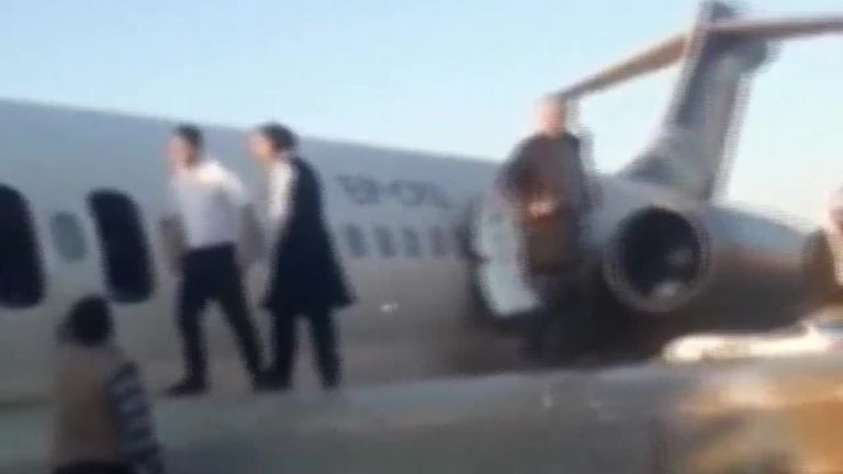 An Iranian passenger airliner crashed onto a street after loosing its landing gear in a hard landing.