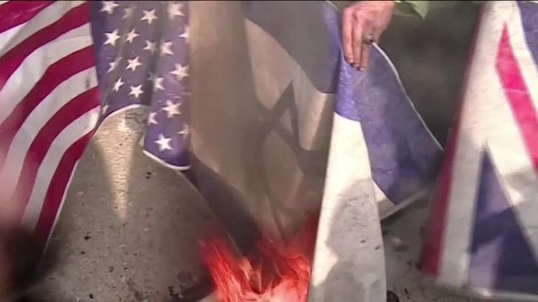 UK, US, Israeli flags burn after airstrikes