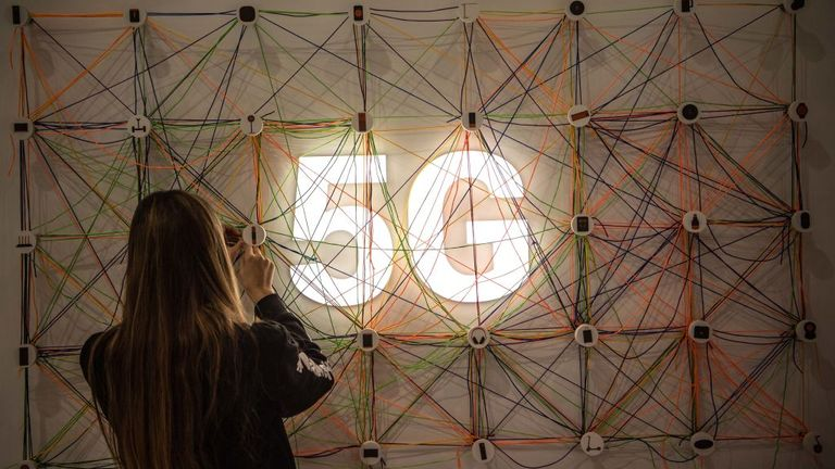 BARCELONA, SPAIN - FEBRUARY 26: A staff member works next to a 5G logo at the Xiaomi booth on day 2 of the GSMA Mobile World Congress 2019 on February 26, 2019 in Barcelona, Spain. The annual Mobile World Congress hosts some of the world's largest communications companies, with many unveiling their latest phones and wearables gadgets like foldable screens and the introduction of the 5G wireless networks. (Photo by David Ramos/Getty Images)