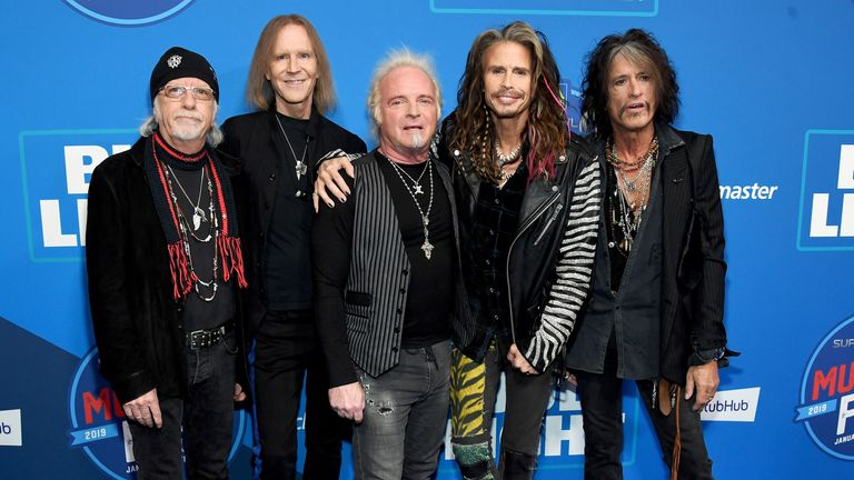 Aerosmith drummer Joey Kramer (C) will not be joining band members (L-R) Bradley Whitford, Tom Hamilton, Steven Tyler and Joe Perry on stage at the Grammys