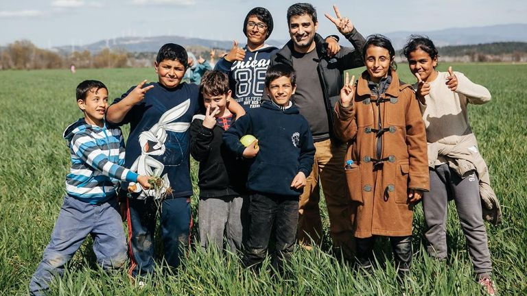 Ahmed Khan with Syrian refugee children in Greece