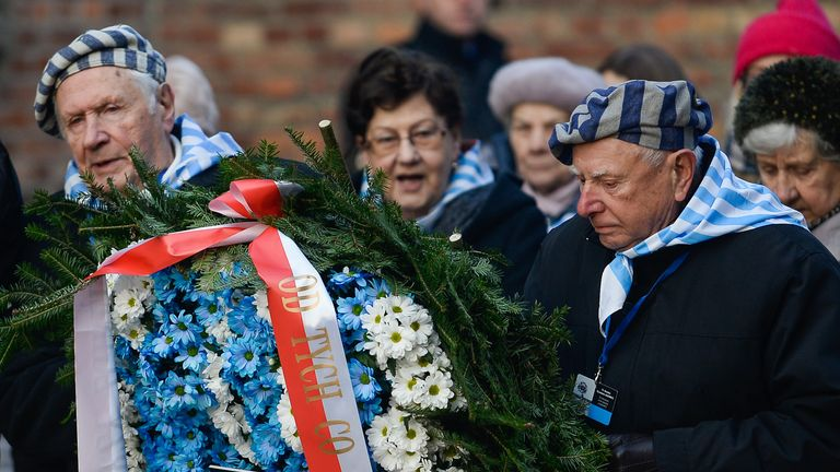 Survivors lay wreaths in honour of victims at the World War Two concentration camp on the 75th anniversary of the camp's liberation
