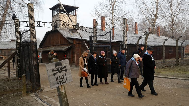 Survivors arrive at the former Nazi German concentration and extermination camp Auschwitz to attend ceremonies marking the 75th anniversary of the liberation of the camp