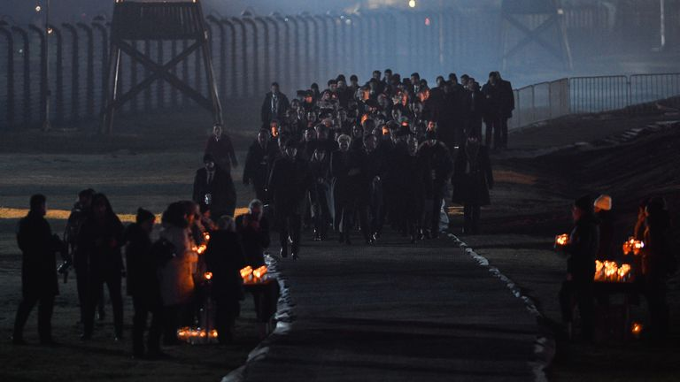 Survivors and their families laid candles at the Auschwitz memorial