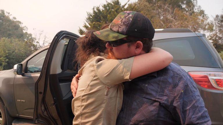 Sam Mitchell's partner Dana sobbed as she said goodbye