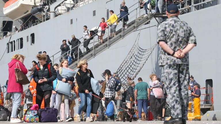 Evacuees from Mallacoota arrive on the navy ship HMAS Choules at the port of Hastings, Victoria