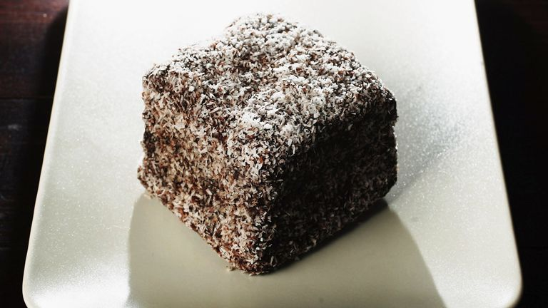 SYDNEY, NSW - JANUARY 25: A Lamington cake is pictured January 25, 2006 in Sydney, Australia. The cake, an Australian specialty, is a cube of plain cake, dipped in melted chocolate and sugar and coated in desiccated coconut. It is said to have been named after Governor General Lord Lamington, a popular governor of Queensland from 1896 to 1901. The nation will celebrate Australia Day on January 26. (Photo Illustration by Ian Waldie/Getty Images)