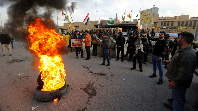 Protesters and militia fighters outside the US embassy in Baghdad