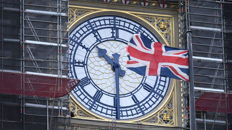 The Union flag flutters near the clockface of Big Ben during ongoing renovations to the Tower and the Houses of Parliament, in central London on January 17, 2020. (Photo by DANIEL LEAL-OLIVAS / AFP) (Photo by DANIEL LEAL-OLIVAS/AFP via Getty Images)