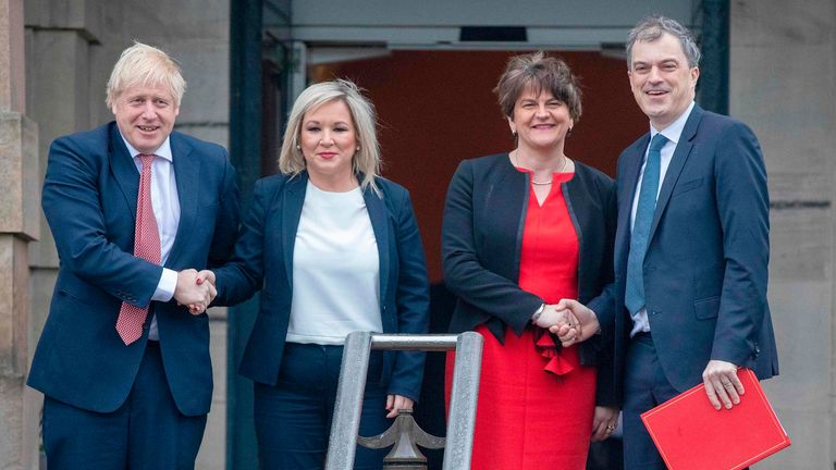 Britain's Prime Minister Boris Johnson (L) and Britain's Northern Ireland Secretary Julian Smith (R) arrive to meet with Northern Ireland's First Minister Arlene Foster (2R) and Deputy First Minister Michelle O'Neill