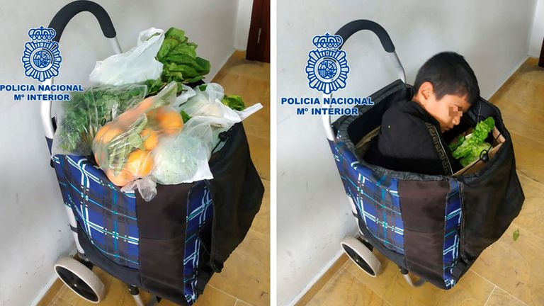 A 10-year old boy, hidden inside a shopping cart, after Spanish policemen discovered him in the city of Melilla, Spanish enclave in northern Africa. Pic: Spanish Police/EPA-EFE/Shutterstock