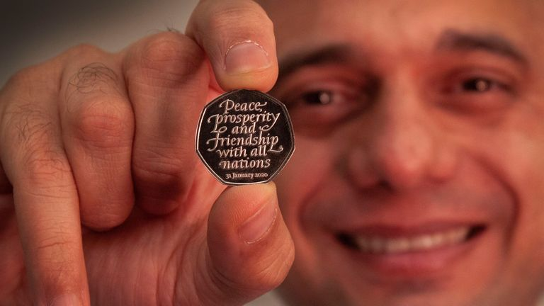 Chancellor Sajid Javid holds the Brexit coin bearing the inscription 'Peace, prosperity and friendship with all nations'