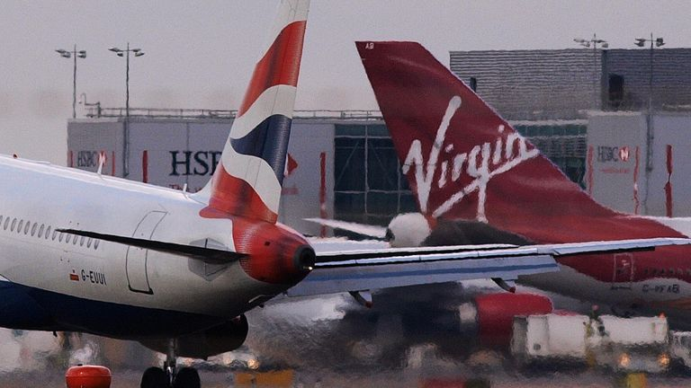 A British Airways and a Virgin Atlantic planes are pictured at London's Heathrow airport, on February 13, 2009