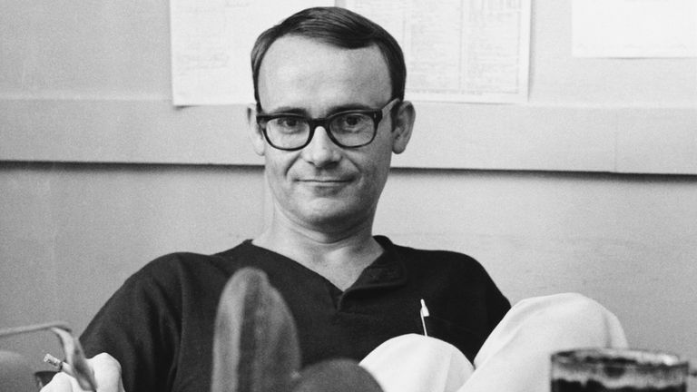 Buck Henry is pictured at his desk in 1966