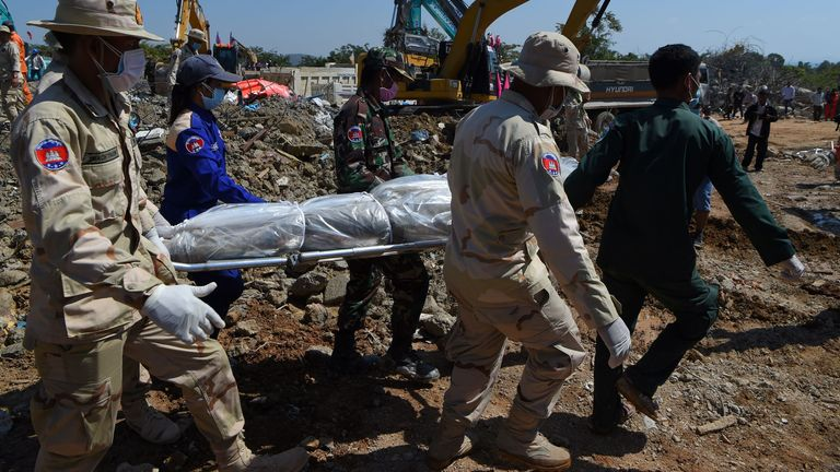 One of the 36 bodies found under the collapsed building was taken away on Sunday
