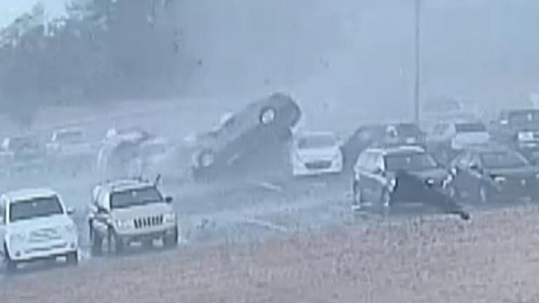 Vehicles fly in 90mph wind in US school car park
