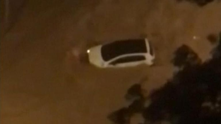 A car was seen floating down a flooded street in the Brazilian city of Belo Horizonte after devastating rains triggered landslides and flooding.