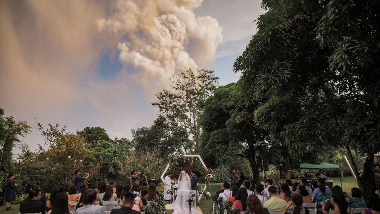 The couple are said to have remained 'calm and collected' despite the huge eruption behind them