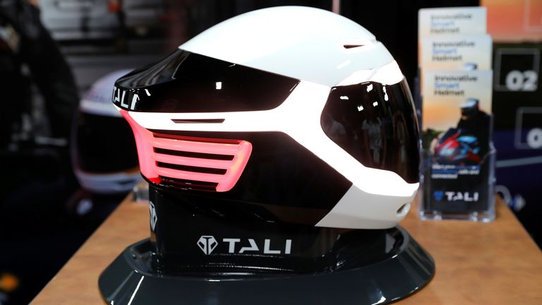 A Tali fully-connected, smart helmet with navigation, lights and photochomic visor