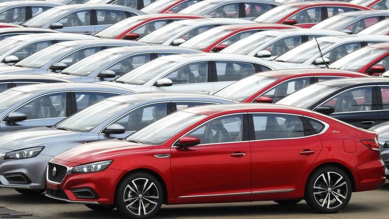Chinese-made cars are readied for export as auto sales in the country fall sharply